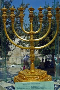 A solid gold menorah, ready for use in the Third Temple, constructed by the Temple Institute. The candelabra is currently showcased in Menorah square overlooking the Western Wall and Temple Mount. (The Temple Institute)