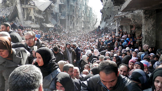 Palestinian refugees in Damascus, Syria, 2014 (Photo: AP)