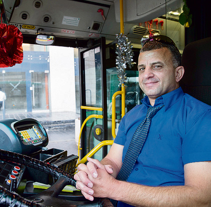 East Jerusalem bus driver Ihab paid for the decorations with his own money (Photo: Amit Shabi)